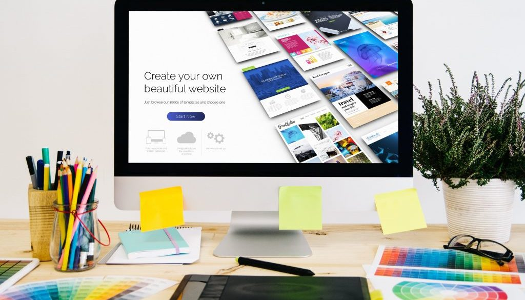 stationery-desktop-with-design-stuff-computer-graphic-tablet-min